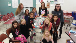 Girl-scouts-making-gift-bags-for-christmas-1024×585